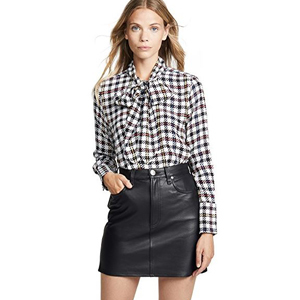 Checkered blouse with a bow accent on the front. photo