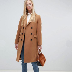 Long trench coat in the color camel. photo