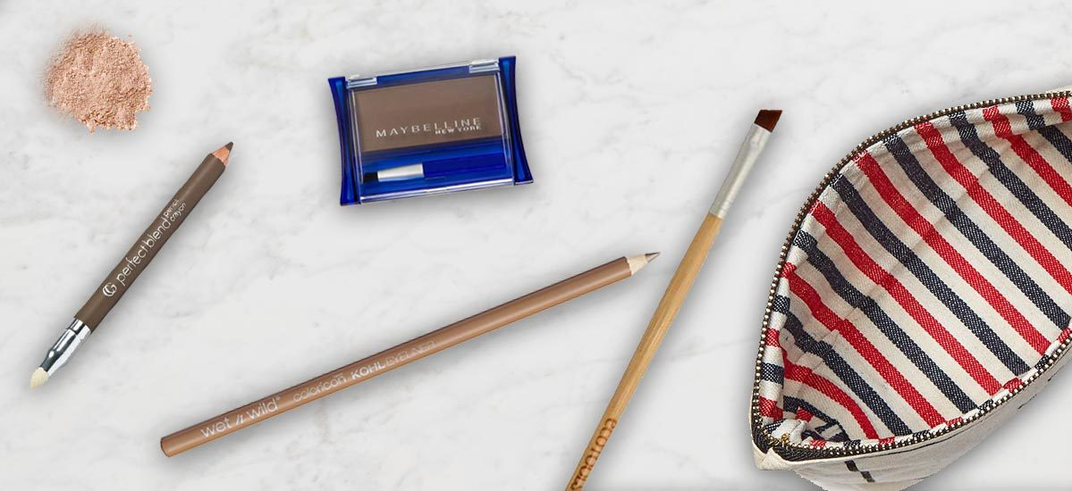 Drugstore beauty products on a marble counter. photo
