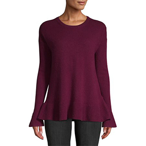 Model wearing a Lord and Taylor cashmere sweater with ruffle sleeves in wineberry photo