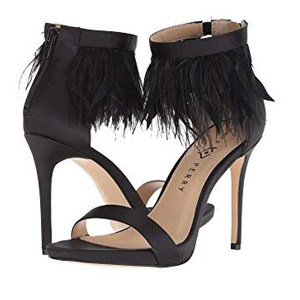 Black heels with feather details around the ankle strap. photo