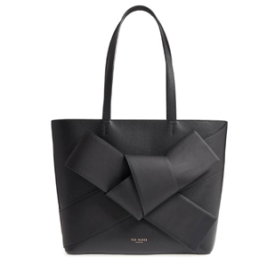 Black Ted Baker London handbag with a knot on the front. photo