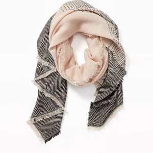 Blanket scarf with a black and ivory chevron pattern. photo