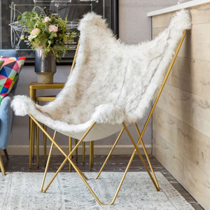 Faux fur butterfly chair in white with gold legs. photo