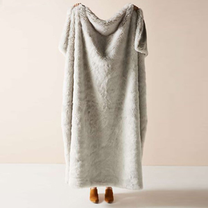 Faux fur throw blanket in gray. photo