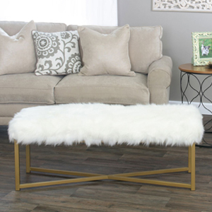 White and gold faux fur bench. photo