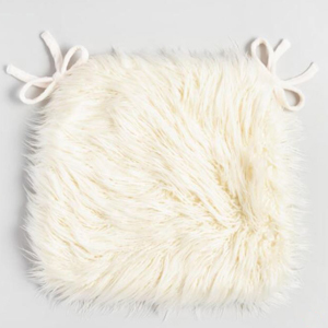 Mongolian faux fur dining chair cushion in ivory. photo