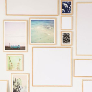 Rustic wood frames in various sizes with prints inside. photo