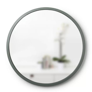 Large round accent mirror with a dark outer edge. photo