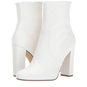 White '70s-inspired leather ankle boots. photo