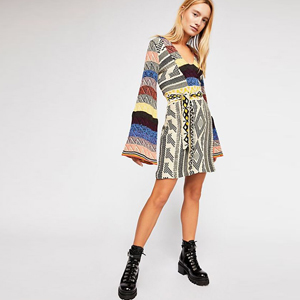 Multi-color Patchwork sweater dress with bell sleeves paired with black combat boots. photo