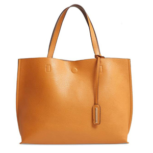 Reversible faux leather tote with wristlet in brown and tan. photo