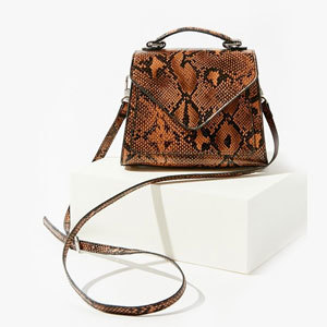 Mini snakeskin trapezoid bag with handle and strap. photo