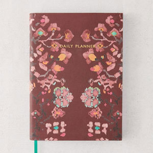 Daily Planner Journal with floral cover and green ribbon bookmark. photo