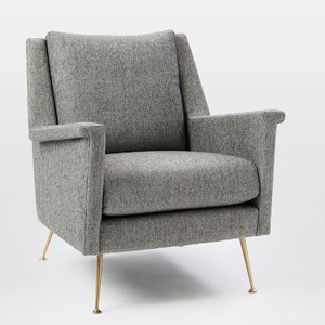 Gray upholstered chair with gold legs. photo