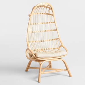 Natural rattan cocoon chair with a cushion. photo