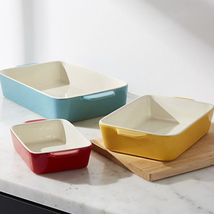 Ceramic casserole dish set with three colorful dishes in three sizes. photo