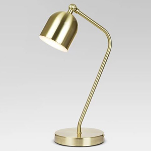 Gold desk lamp with adjustable shade. photo