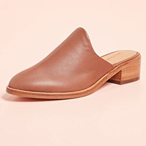 Brown leather mules with a small heel. photo