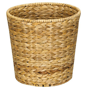 Woven trash can made from banana leaves. photo