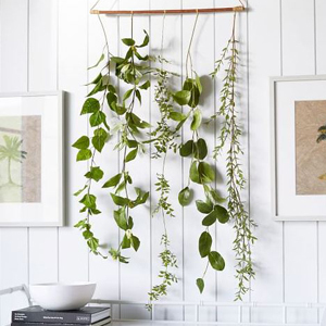 Botanical wall art made with faux plants. photo