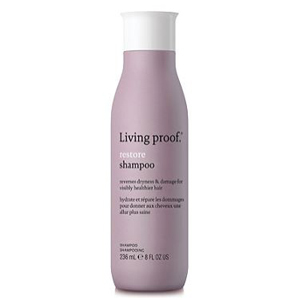 Living Proof shampoo for damaged hair in a purple bottle. photo