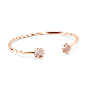 Kendra Scott rose gold bracelet cuff with stone gems on the ends photo