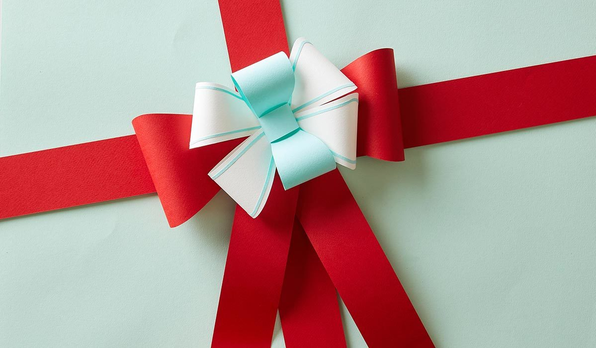 Blue Christmas gift wrapped with red ribbon photo