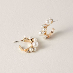 white and gold pearl hoop earrrings from Saachi at BHLDN photo
