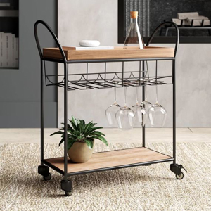 Wood bar cart with a metal frame and wine glass rack. photo