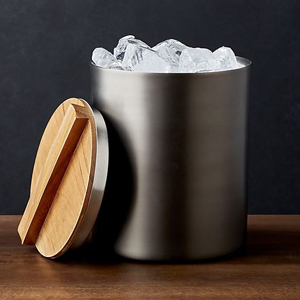Graphite ice bucket with a wooden lid. photo
