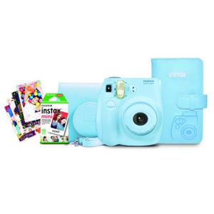 Light blue Fujifilm Instax Mini camera with film and case with photos sitting next to it from Walmart. photo