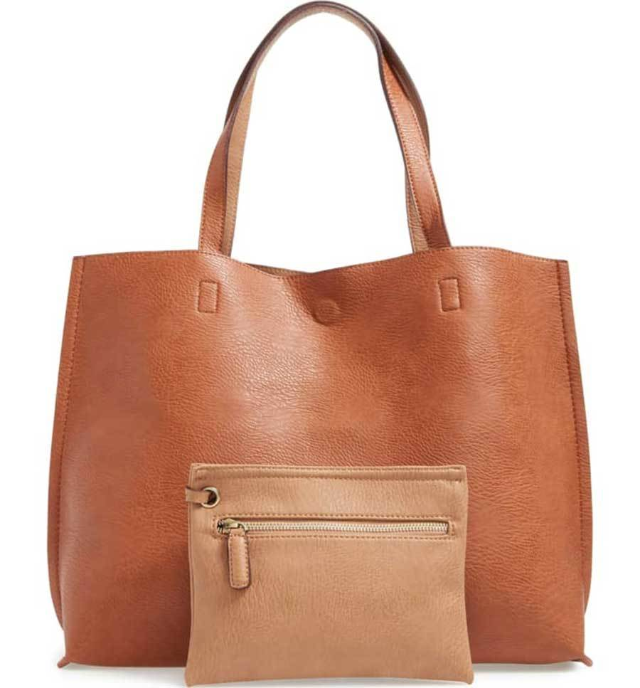 Light brown tote and wristlet. photo