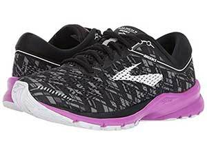 Black, white, and purple running shoes. photo