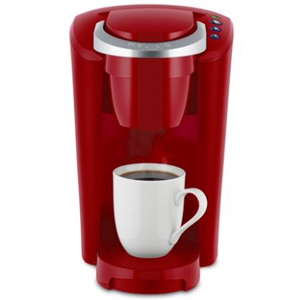 Red Keurig single-serve coffee maker. photo
