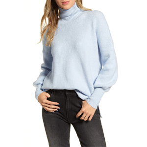 Pale blue turtleneck sweater paired with black jeans from Nordstrom photo