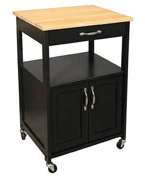 Black wood wheeled kitchen island with a drawer and cabinets and topped with a cutting board photo