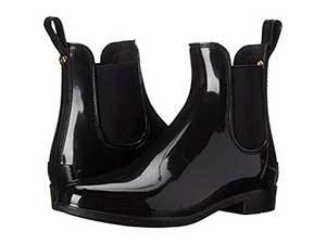 Black glossy rubber Chelsea boots. photo