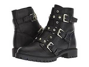 Black leather motorcycle boots with rivets and straps. photo