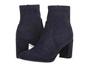 Navy blue stacked heel boots with a narrow ankle. photo