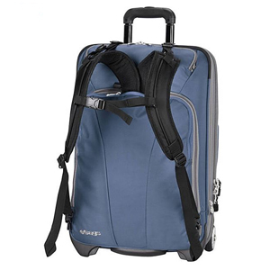 Blue carry-on backpack with wheels. photo