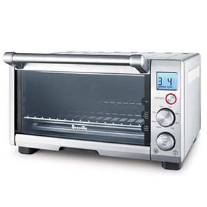 Abt Smart Oven in silver with a temperature and timer knob photo