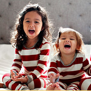 red-and-white rugby-style striped family matching pajamas from Burt's Bees Baby photo