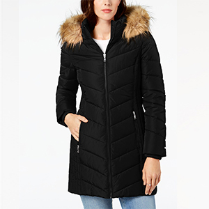 Woman wearing black puffer coat with fur hood from Macy's. photo