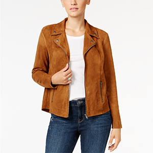Woman wearing a faux-suede moto jacket in saddle color from Macy's paired with a white t-shirt and jeans photo