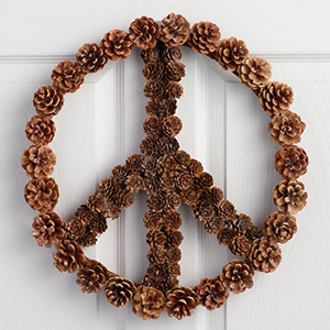 Pinecone wreath in a shape of a peace sign photo