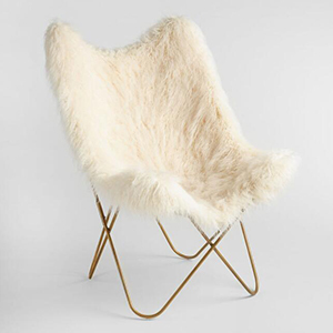 White faux fur butterfly chair with gold legs photo