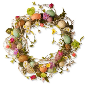 Straw wreath with colorful Easter eggs and flowers. photo