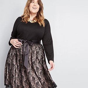 Long-sleeve plus-size cocktail dress in black photo