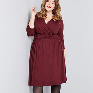 Long-sleeve cocktail dress in wine photo